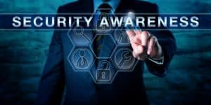59645205 - industry consultant is pressing security awareness on an interactive touch screen interface. information technology concept for both computer or cyber security and physical asset protection.